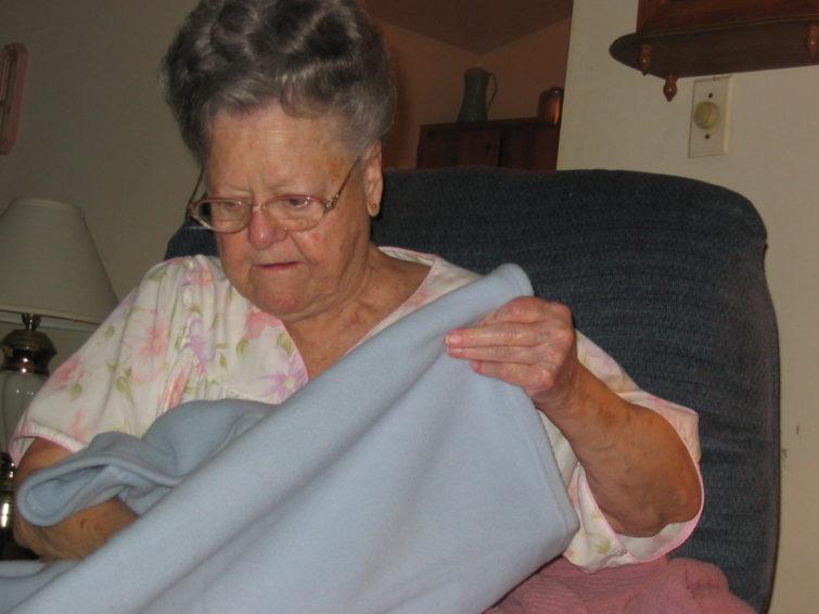 Grandma Joyner opening her presents on her last birthday.