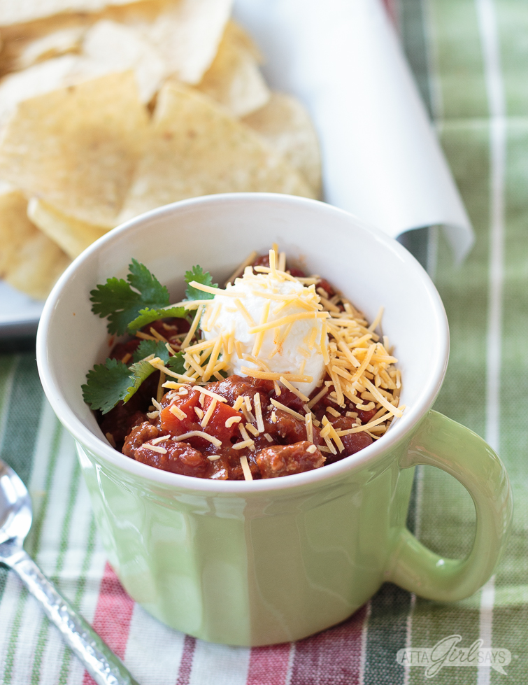bowl of chili topped with sour cream and cheese