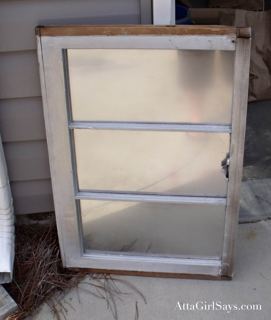 Love the look of antique mirrors and mercury glass, but not the high price? Click to learn how to make your own faux mercury glass window pane mirror using spray paint and vinegar.
