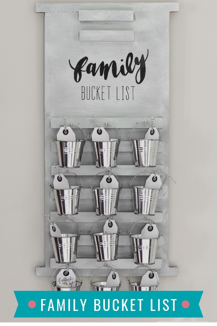 wooden board family bucket list with galvanized buckets