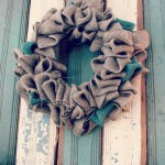 Burlap wreath on old wainscoting