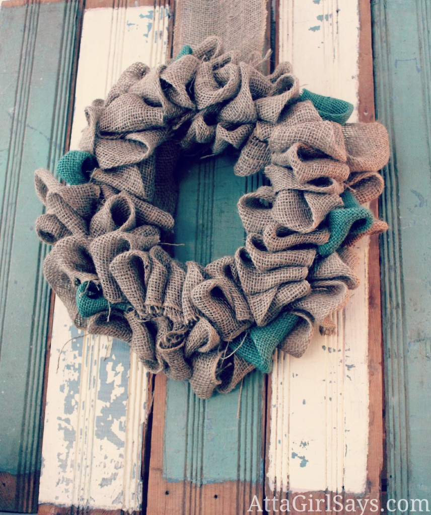Burlap wreath on old wainscoting by AttaGirlSays.com