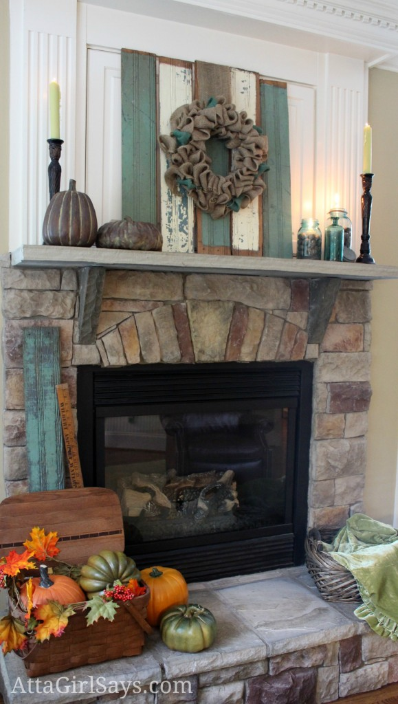 Rustic chippy wood fall mantel in aqua blue by AttaGirlSays.com. Looking to decorate your mantel for fall? You'll love these fireplace mantel ideas featuring chippy wood, natural elements and shades of aqua and cream.