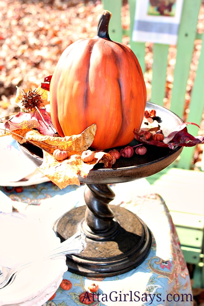 Thanksgiving feast pumpkin pedestal decorating with natural elements fall leaves