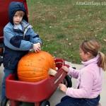 fun kids Halloween activity hammering golf tees in pumpkins by AttaGirlSays.com