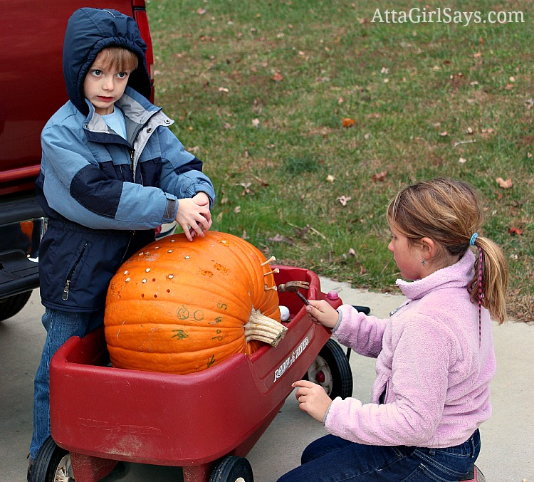 fun kids Halloween activity hammering golf tees in pumpkins by AttaGirlSays.com