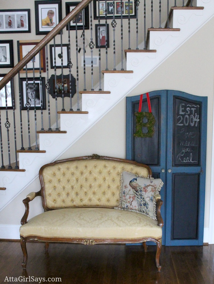 living room French settee and chalkboard armoire doors