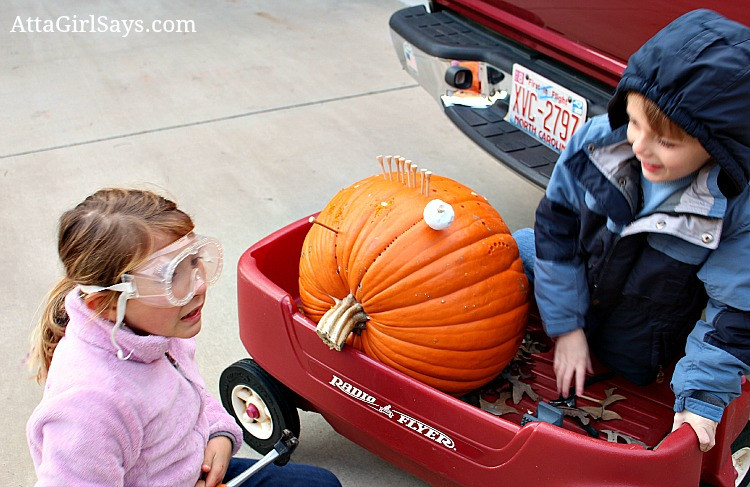 wear safety goggles fun kids Halloween activity hammering golf tees in pumpkins by AttaGirlSays.com