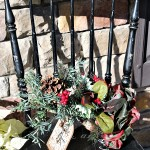 sit a spell chair with arrangement made of old garden hoe decorated for Christmas