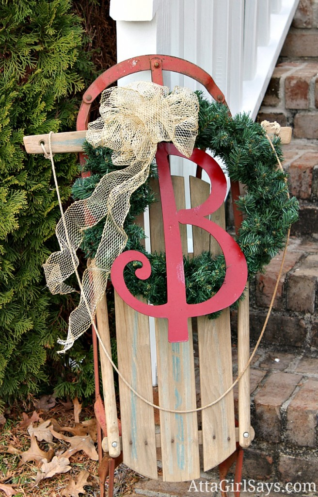 decorated Christmas sled front porch decor from AttaGirlSays.com