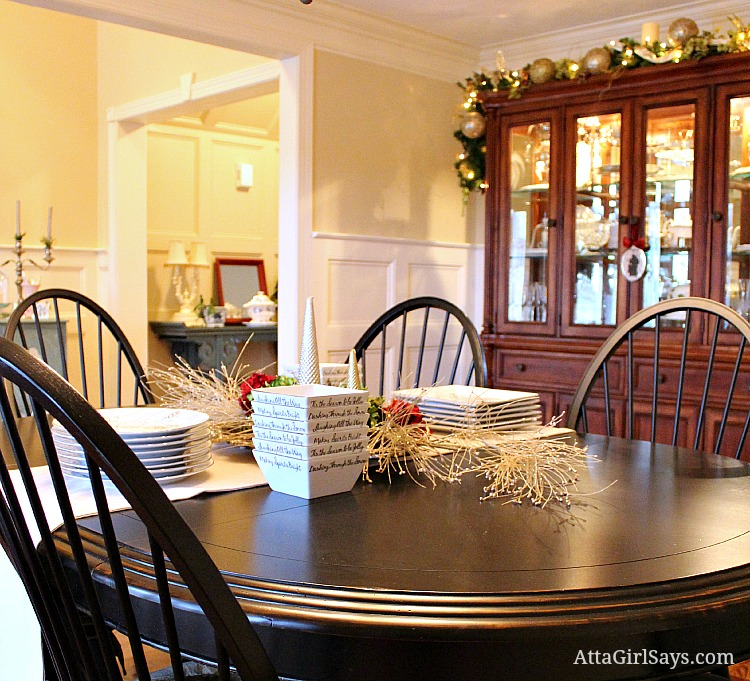 dining room decorated for Christmas simply in silver and gold