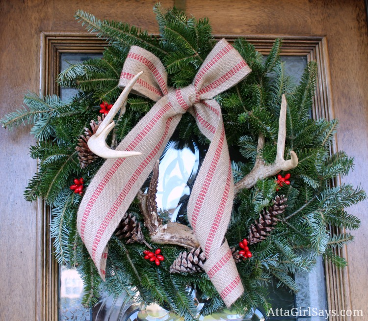 antlers in evergreen Christmas wreath by AttaGilrSays.com
