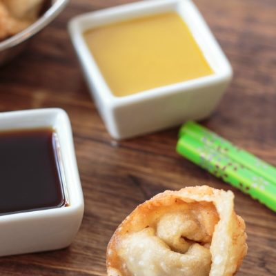 This is the absolute best party appetizer ever! I've been using this same fried wontons recipe for 30 years. I usually make a double batch for parties, and there are never any leftovers! You just need a few ingredients to make these, and it's easier than you think to fold the wontons.