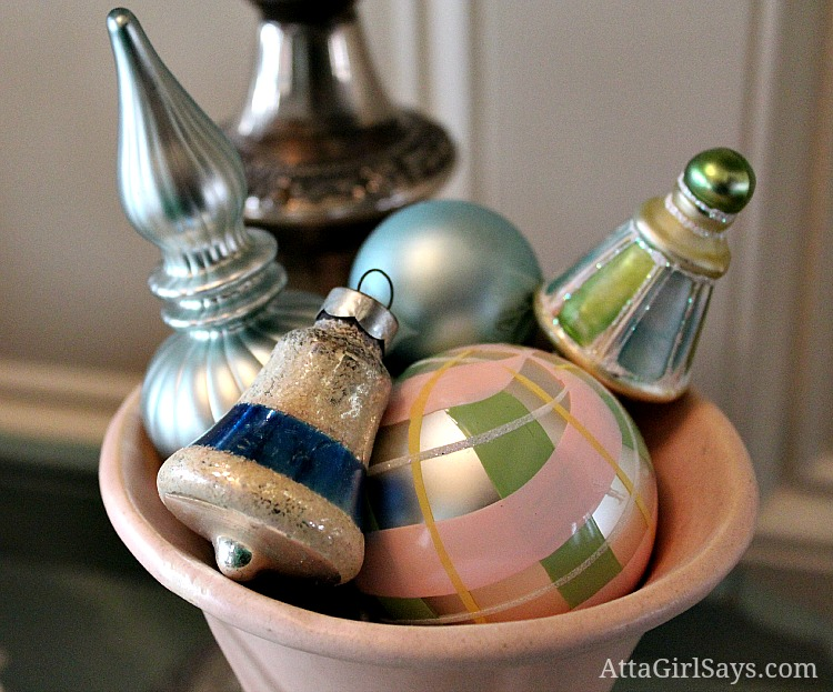 vintage pink and green Christmas ornaments in McCoy vase