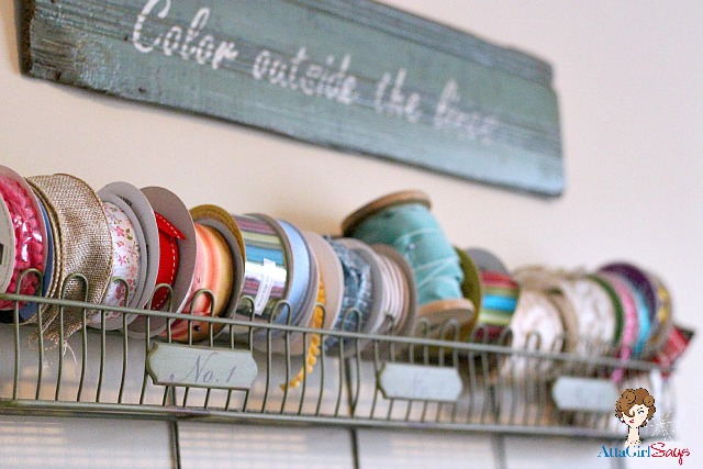 French ribbon storage rack and handpainted sign in office