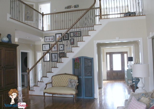 Atta Girl Says: Living Room View of stairs and front door