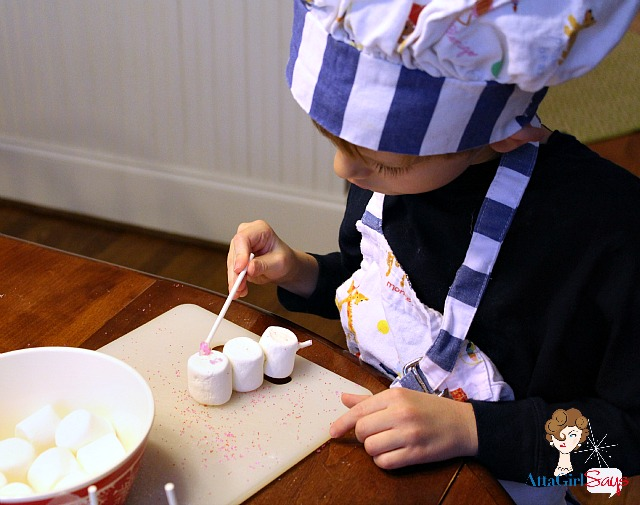 Making snowman marshmallow pops