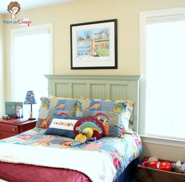 little boy's bedroom decorated with dinosaur bedding
