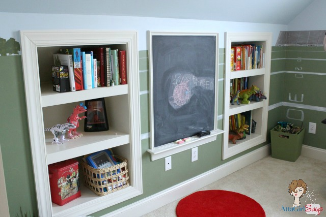 playroom with sports mural and built-in storage shelves and chalkboard