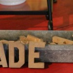 FEATURED MADE sign and iron finials