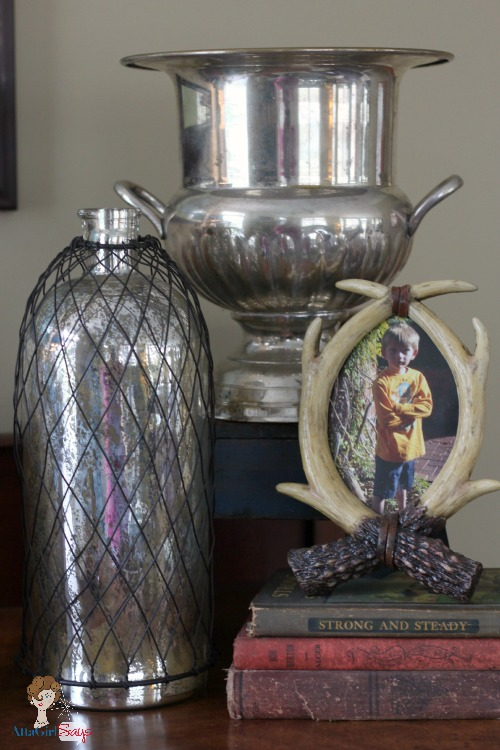 Vintage Champagne bucket mercury glass and antlers on sideboard