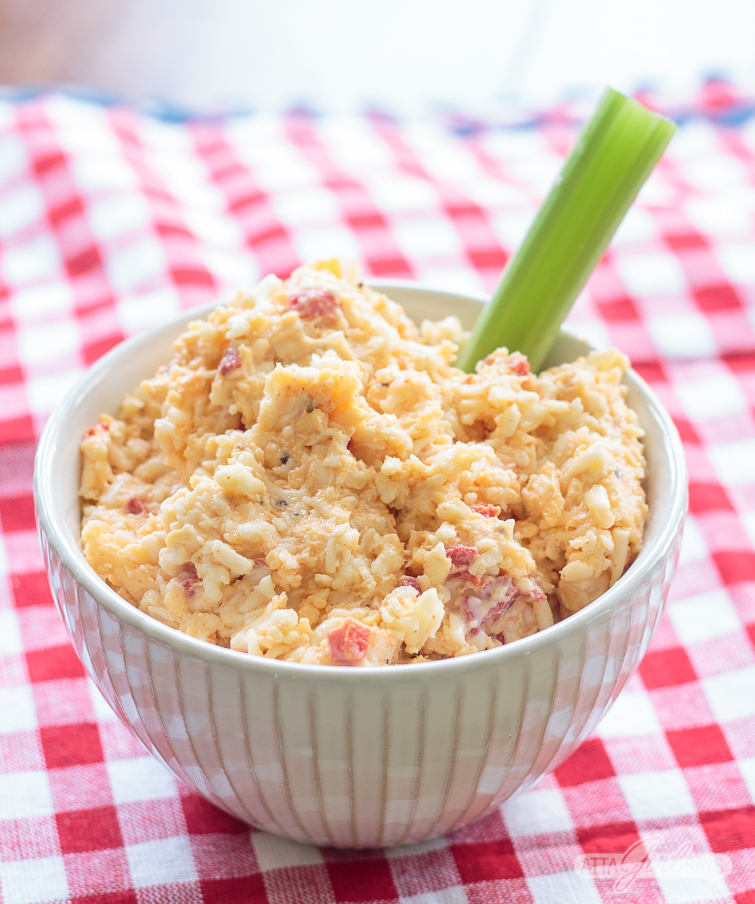bowl of homemade pimento cheese with a celery stick