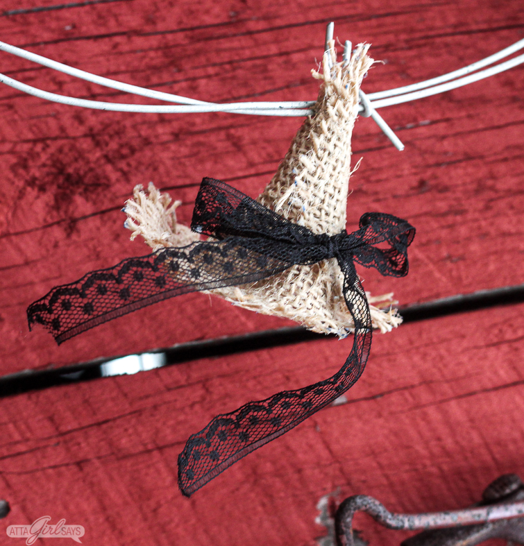 burlap witch hat on barbed wire