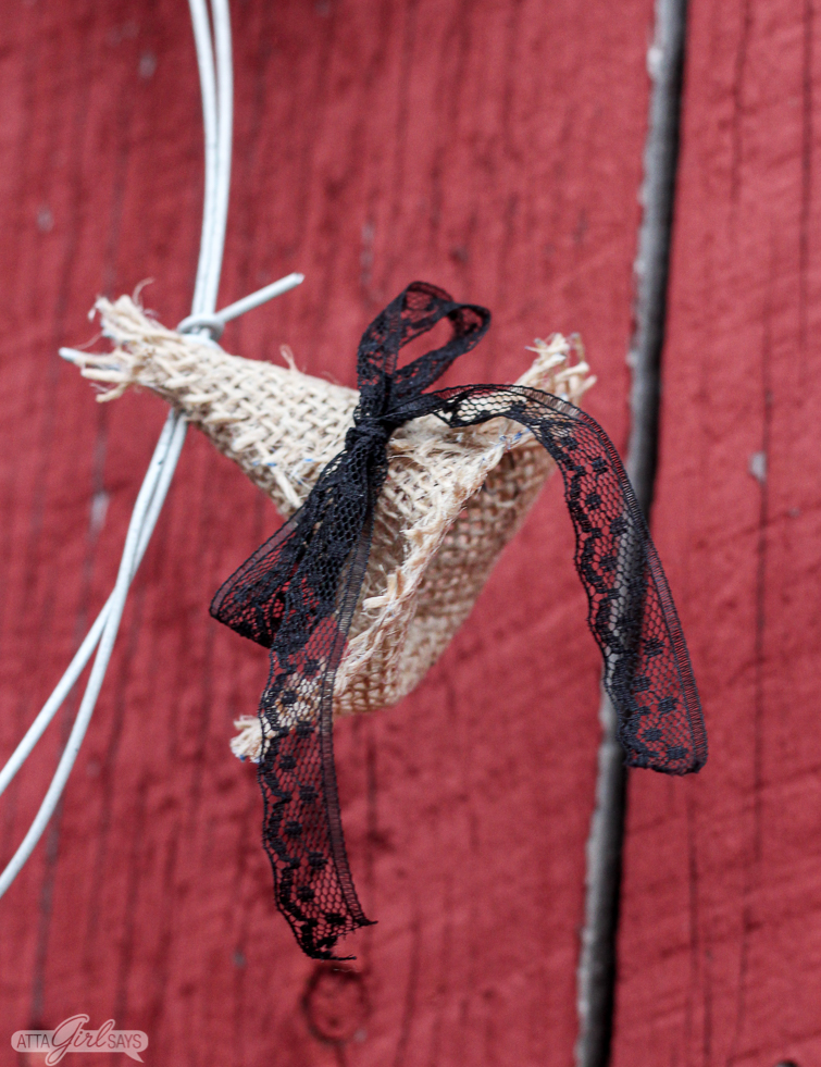 close up of a burlap witch hat on a barbed wire Halloween wreath