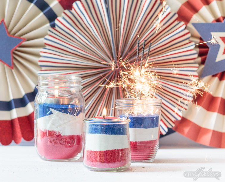 red white and blue sand in jars with sparklers in them for July 4th