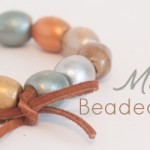 These painted metallic beaded bracelets are so easy to make with wooden beads, leather cording and metallic paint. The mixed metals look is hot in fashion right now, and these will work silver, gold, bronze and platinum accessories.