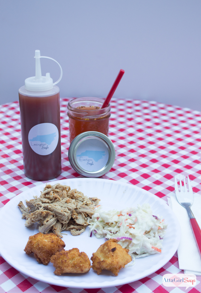 plate of North Carolina barbecue, hushpuppies and slaw with Eastern-style barbecue sauce and Lexington-style barbecue sauce
