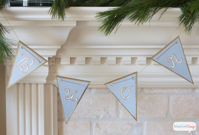 "Bring a little international flair to your Christmas decorating with this handpainted Christmas banner embellished with the phrase, ""Buon Natale,"" Italian for Merry Christmas"