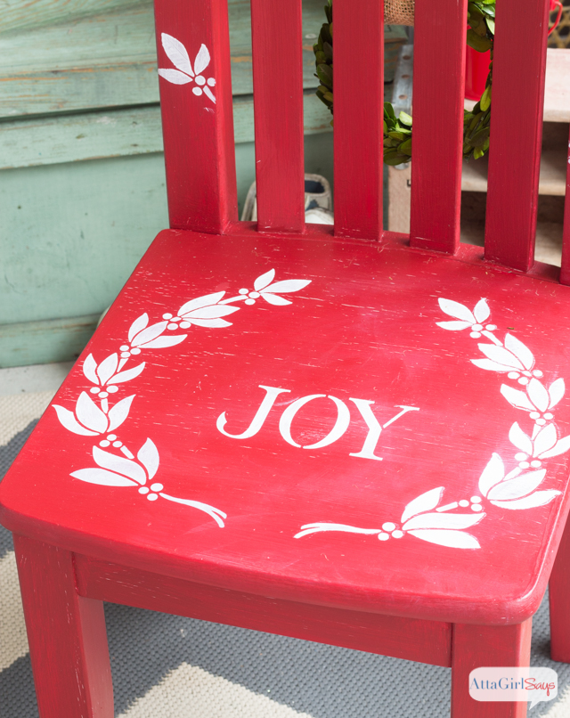 Use Christmas stencils to paint a child's chair for photos