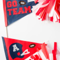 Looking for some easy, do-it-yourself Super Bowl party decorations? These football pennants and pom-poms are easy enough for kids to make. There's absolutely no sewing involved, and they're made from a durable weather-proof material. Click for the free pattern and a video tutorial.