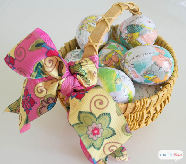 yellow basket filled with decoupaged Easter eggs
