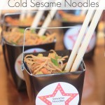 cold sesame noodles and chopsticks in takeout containers or a party table
