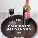 Upcycle a deep dish pizza pan into a wine barrel tray or a wine barrel sign inspired by Ballard Designs
