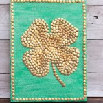 Use a painter's canvas and gold thumb tacks from the dollar store to make this lucky four leaf clover artwork. This is a great St. Patrick's Day project for kids.