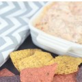 "This Slow Cooker Chili Cheese Dip is always the hit of the party! And it's so easy to make! Sometimes called ""white trash dip,"" it's made with just three ingredients. Just dump them all into the Crock Pot, stir and heat!"
