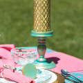 Love the look of gilding, but not the price? Learn how to DIY these turquoise and gold candlesticks and matching placecards using craft paint.