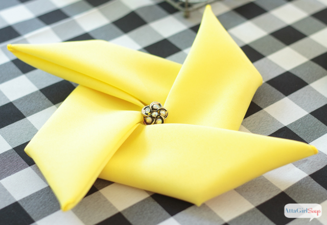 Quick and easy video tutorial on how to fold napkins into a pinwheel shape. This pinwheel napkin fold trick works with cloth napkins or paper napkins. Such a fun touch for a summer party or a carnival theme event.