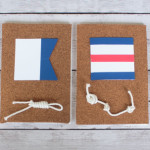 What a cool idea for a beach house or a nautical bedroom. Use nautical signal flags to spell out someone's name, then add some sailing knots as a finishing touch. Too cute!