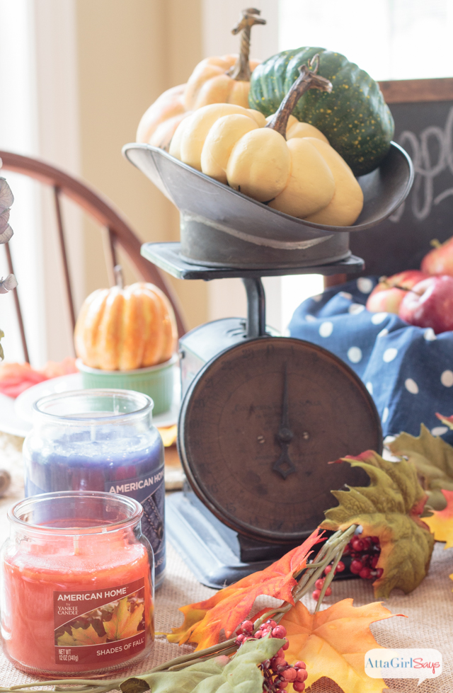 These fall table decorations were inspired by a trip to the farm. Apples, pumpkins, denim and candles in fabulous fall scents help set the scene. #LoveAmericanHome #ad #cbias