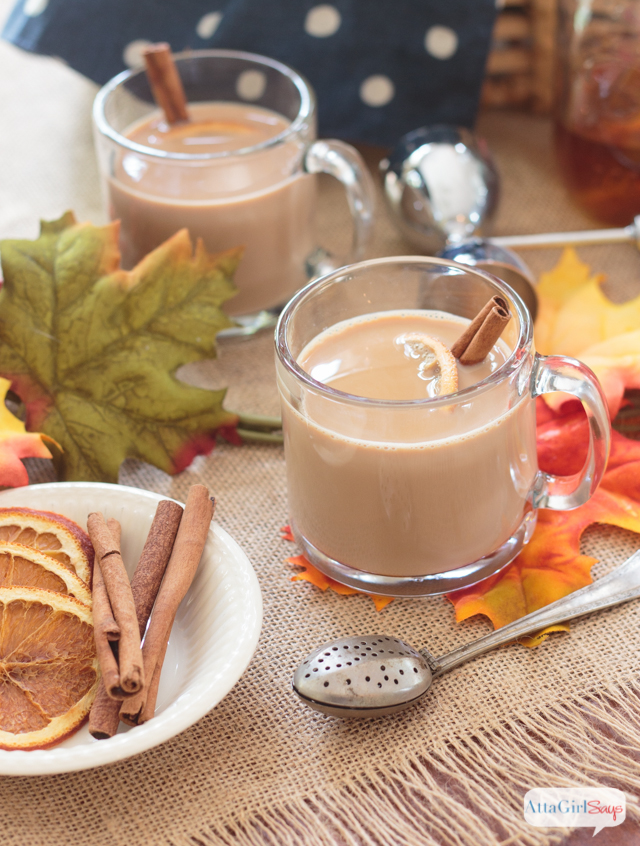 chai tea lattes on a fall table with dried orange slices