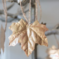 I've seen a lot of fall leaf craft ideas, but this might be my favorite! Use liquid giilding in a variety of colors to give faux leaves a metallic sheen.