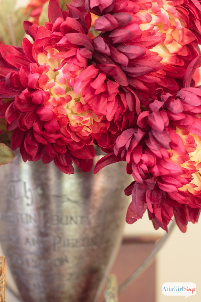 How to decorate a mantel using traditional fall colors and natural elements.