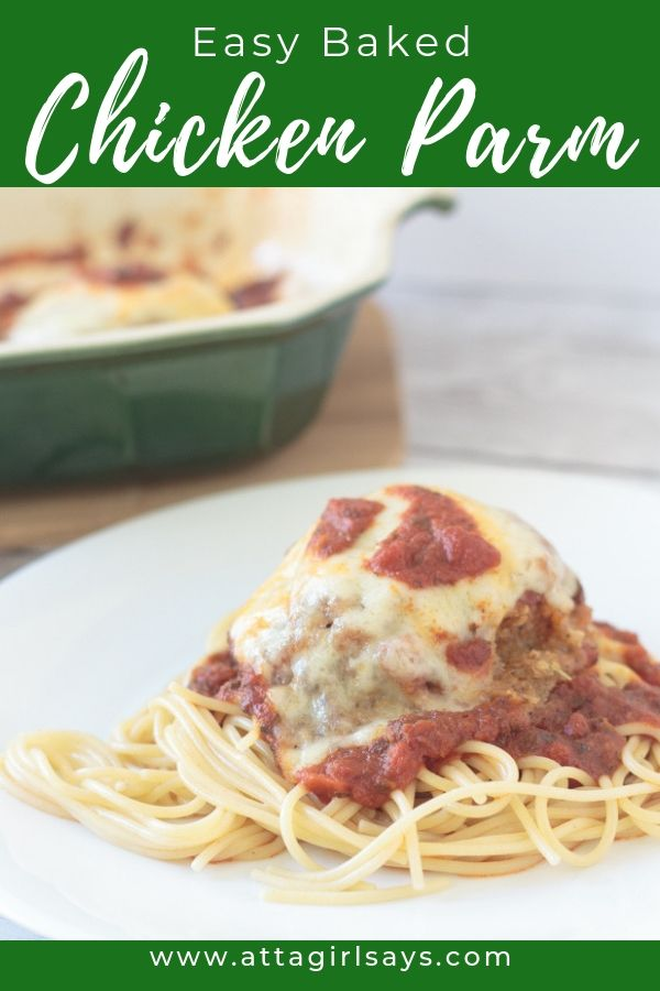 easy baked parmesan chicken on a white plate atop spaghetti noodles