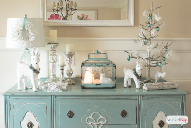 create a winter wonderland using snowy white christmas decorations accented with aqua ad