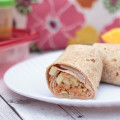 These easy Asian Turkey Sandwich Wraps are the perfect lunch-on-the-go. Made with lean turkey, brown rice, veggies and whole wheat wraps and served with a spicy peanut sauce. #sponsored