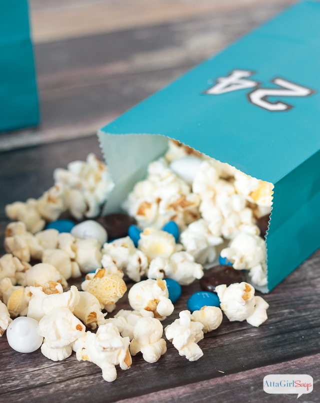 Add this easy-to-make popcorn snack mix to your Game Day food lineup. Don't forget to serve it in color coordinated bags featuring your favorite players' jersey numbers. #BringtheBOOM #ad